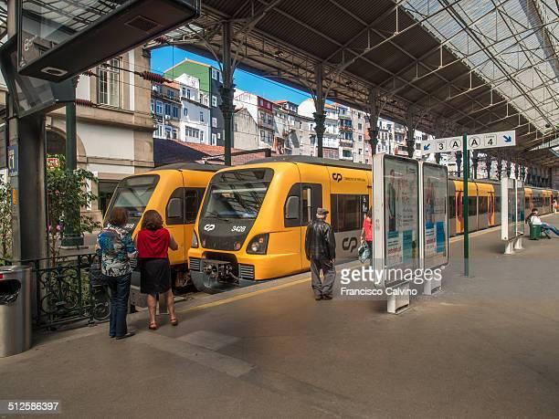 Travellers proceeding to trains at São Bento railway station Comboios de Portugal Porto Portugal