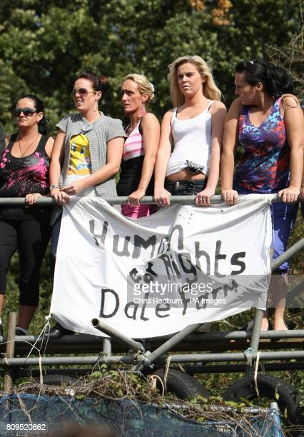 Travellers protest from a platform from the front gate at Dale Farm travellers' site at Cray's Hill near Basildon Essex where bailiffs will later...