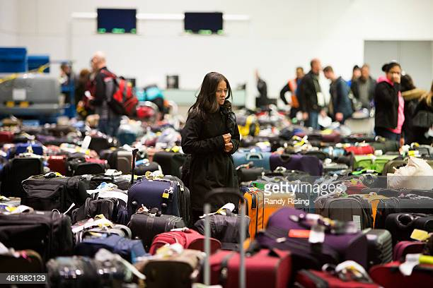 Travellers scour the baggage claim at Toronto's Pearson airport for their luggage Cold weather has caused a series of delayed or cancelled flights...