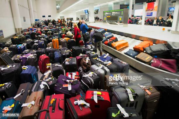 Travellers scour the baggage claim at Toronto's Pearson airport for their luggage Cold weather has caused a series of delayed or cancelled flights