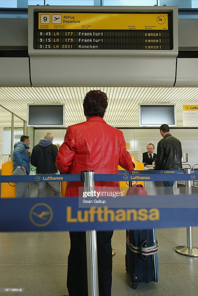 Travellers seek assistance at a Lufthansa check-in counter under a departures board that shows cancelled Lufthansa flights at Tegel Airport during a nationwide strike by Lufthansa ground, service and maintenance personnel on April 22, 2013 in Berlin, Germany. Workers are demanding pay raises and job guarantees and today's strike has forced Lufthansa to cancel approximately 1700 flights.