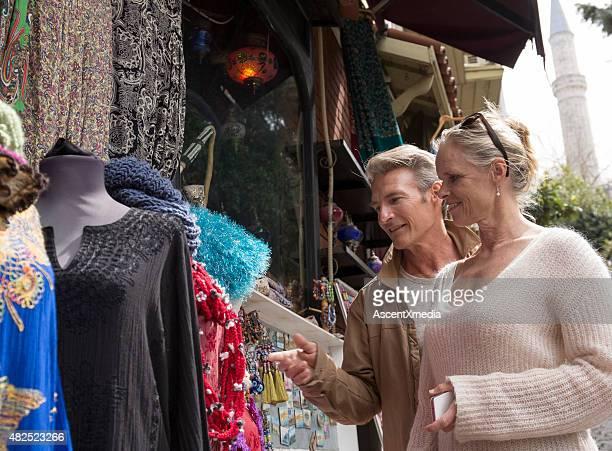 Travellers shop for handicrafts in bazaar