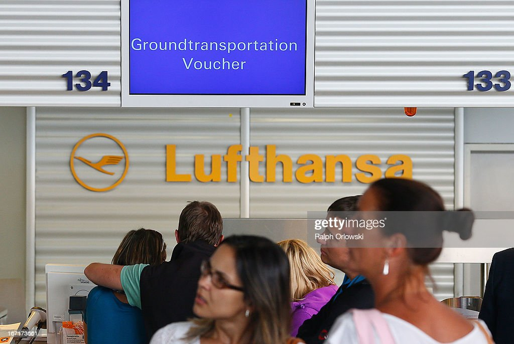Travellers wait at a Lufthansa counter to change their flight tickets into train vouchers to reach their domestic German destination during a nationwide strike by Lufthansa ground, service and maintenance personnel at Frankfurt Airport on April 22, 2013 in Frankfurt, Germany. Workers are demaning pay raises and job guarantees and today's strike has forced Lufthansa to cancel approximately 1700 flights.