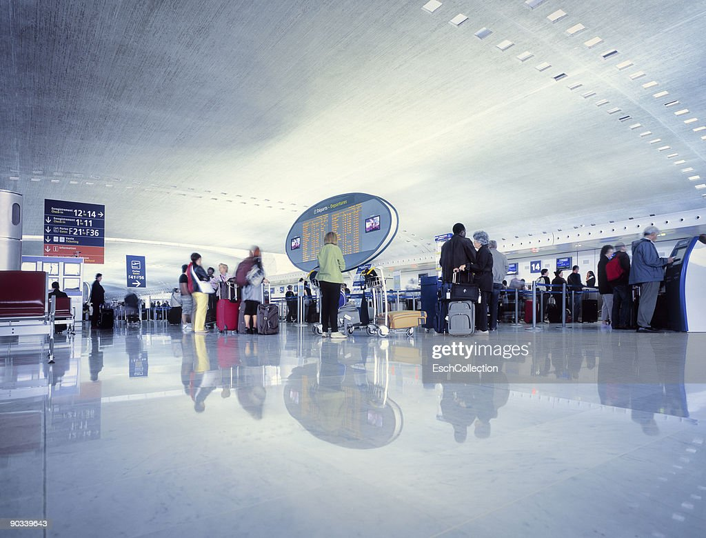 Travellers waiting for check-in at the airport. : Stock Photo