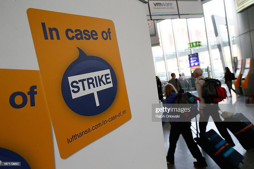 Travellers walk along a sign during a nationwide strike by Lufthansa ground, service and maintenance personnel at Frankfurt Airport on April 22, 2013 in Frankfurt, Germany. Workers are demaning pay raises and job guarantees and today's strike has forced Lufthansa to cancel approximately 1700 flights.