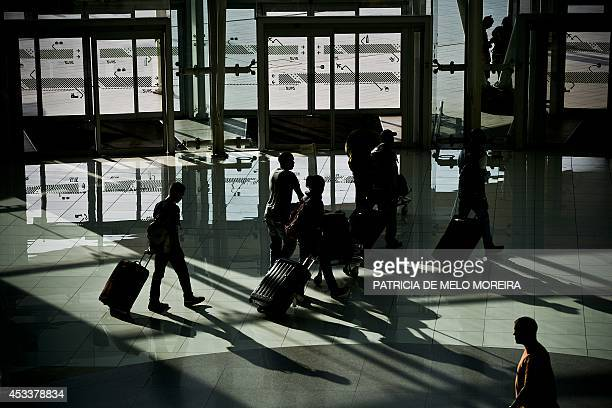Travellers walk in the main lobby of Lisbon's Airport during a strike on August 9 2014 Pilots at Portuguese stateowned airline TAP staged a 24hour...