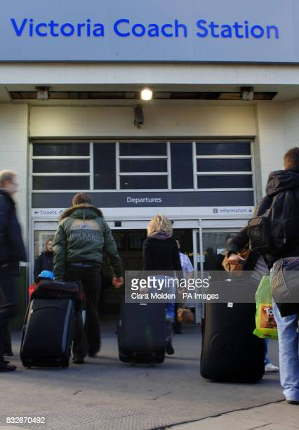 Travellers with suitcases enter Victoria coach station London