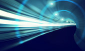A blurred motion shot of a high-speed train moving through a tunnel - ALL design on this image is created from scratch by Yuri Arcurs'  team of professionals for this particular photo shoot