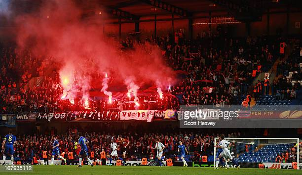 Travelling fans from Basel light flares during the UEFA Europa League semifinal second leg match between Chelsea and FC Basel 1893 at Stamford Bridge...