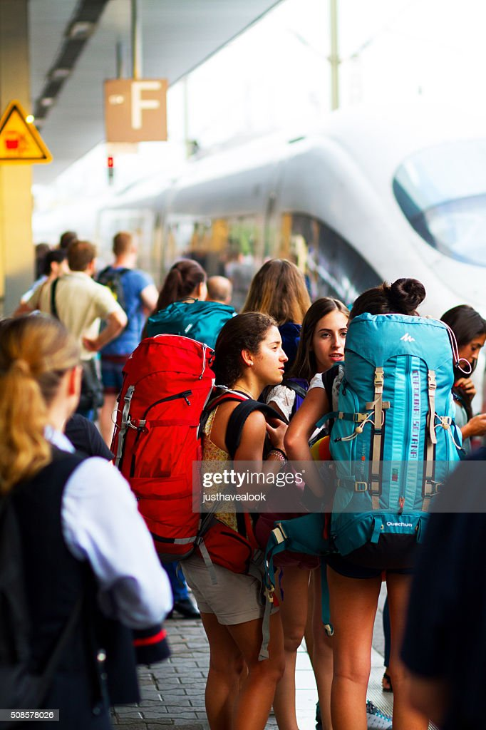 Travelling girls with backpacks : Stock Photo