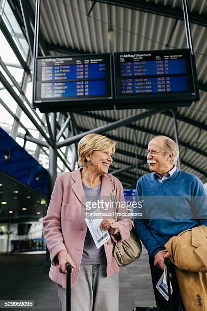 Travelling Senior Couple At The Airport