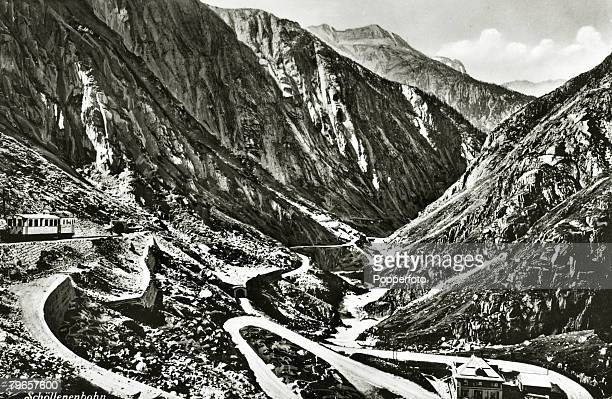 circa 1900 The St Gotthard Pass in Switzerland showing on the left the railway and entrance to the tunnel the railway line being completed in 1880...