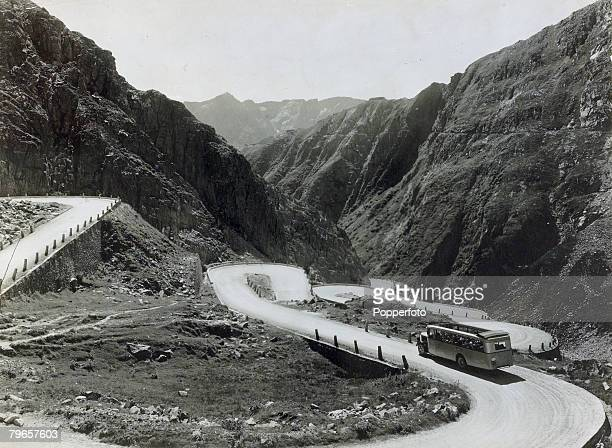 circa 1930's The St Gotthard Pass in Switzerland showing a bus negotiating the curves Now a better road and new tunnel for road traffic have been...