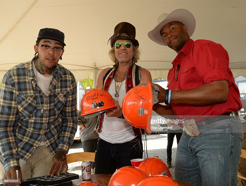 Travie McCoy of Gym Class Heroes, Big Kenny of Big & Rich and Cowboy Troy backstage of 'ESPN GameDay' opening taping as Big & Rich, Cowboy Troy, Lizzie Hale and Travie McCoy perform at The Woods Amphitheater at Fontanelon May 7, 2014 in Nashville, Tennessee.