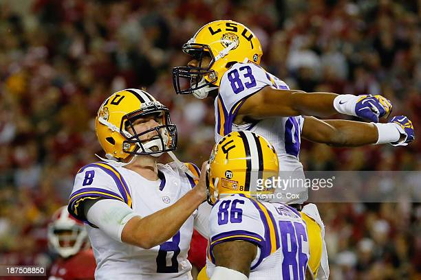 Travin Dural of the LSU Tigers celebrates his touchdown reception with teammate Zach Mettenberger in the second quarter against the Alabama Crimson...