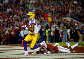 Travin Dural of the LSU Tigers scores with a touchdown reception against Geno MatiasSmith of the Alabama Crimson Tide in the second quarter at...