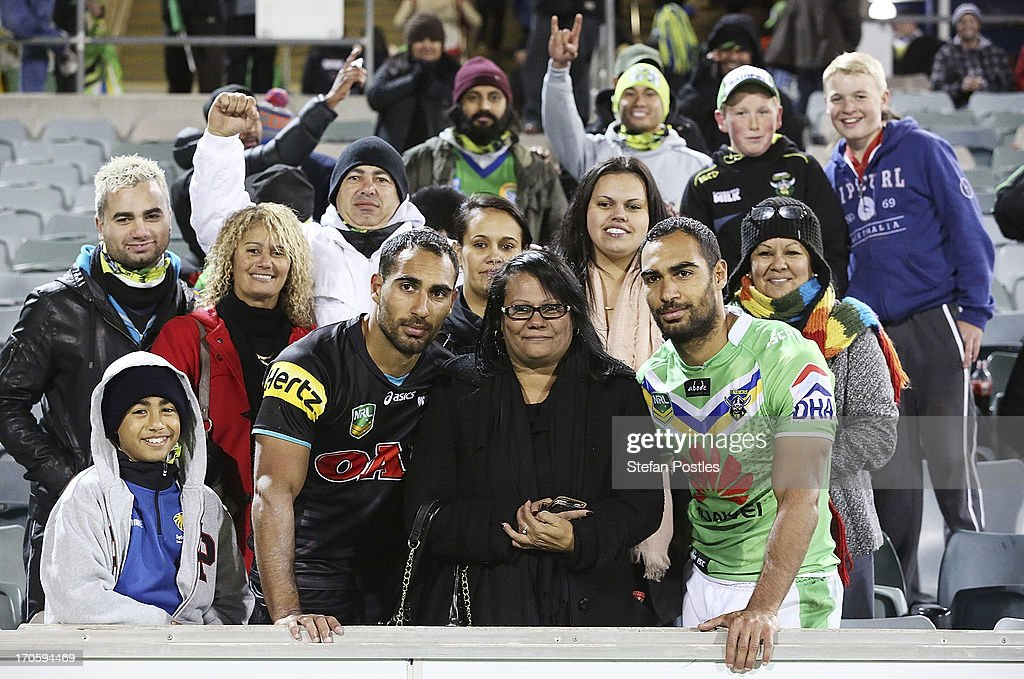 Travis and Reece Robinson pose for a photo with their mom Christine Robinson after the round 14 NRL match between the Canberra Raiders and the Penrtih Panthers at Canberra Stadium on June 15, 2013 in Canberra, Australia.