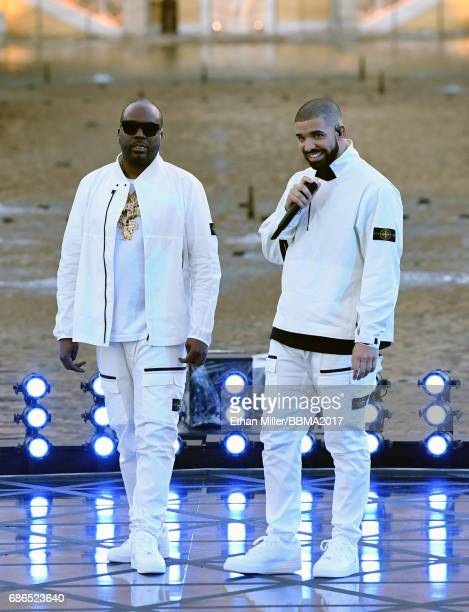 Travis 'Baka' Savoury and recording artist Drake get ready to perform during the 2017 Billboard Music Awards at The Fountains of Bellagio on May 20...