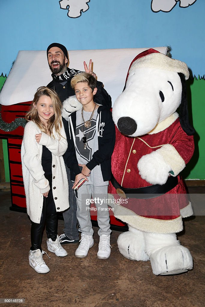 Travis Barker Alabama Luella Barker Landon Asher Barker and Snoopy attend Knott's Berry Farm's Countdown to Christmas and Snoopy's Merriest Tree...