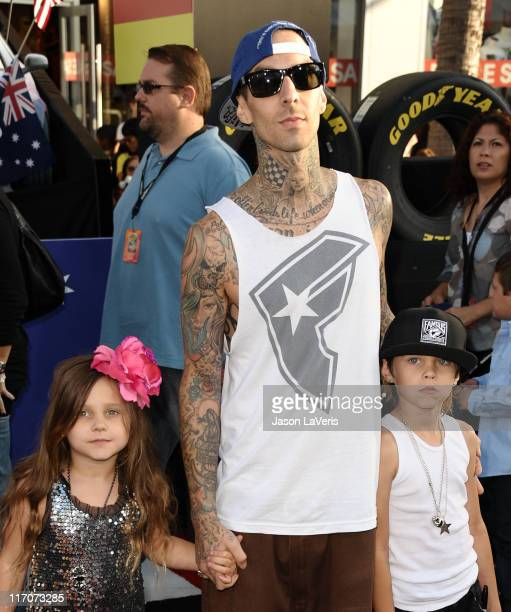 Travis Barker and daughter Alabama Luella Barker and son Landon Asher Barker attend the premiere of Disney/Pixar's 'Cars 2' at the El Capitan Theatre...