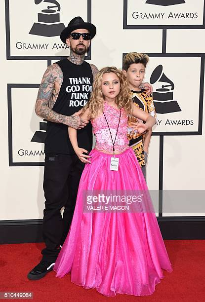 Travis Barker and his kids arrive on the red carpet for the 58th Annual Grammy music Awards in Los Angeles February 15 2016 AFP PHOTO/ VALERIE MACON...