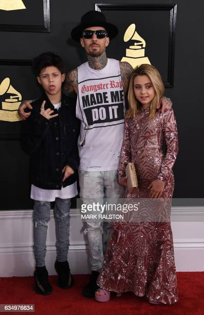 Travis Barker Landon Barker and Alabama Barker arrives for the 59th Grammy Awards on February 12 in Los Angeles California / AFP / Mark RALSTON
