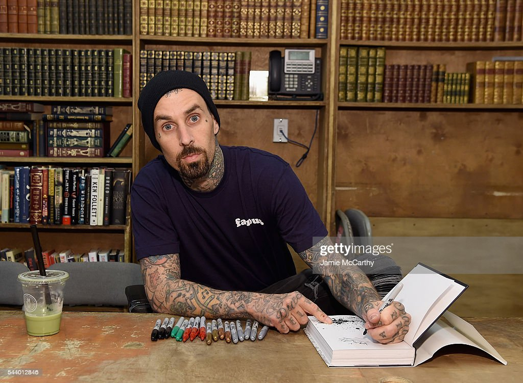 <a gi-track='captionPersonalityLinkClicked' href=/galleries/search?phrase=Travis+Barker&family=editorial&specificpeople=213206 ng-click='$event.stopPropagation()'>Travis Barker</a> signs copies of his book 'Can I Say: Living Large, Cheating Death, and Drums, Drums, Drums' at Strand Bookstore on June 30, 2016 in New York City.