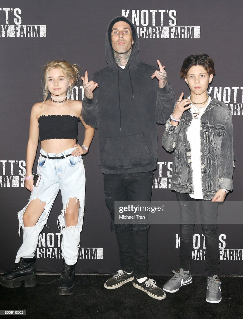 Travis Barker with his children, Alabama Luella Barker and Landon Asher Barker arrive at Knott's Scary Farm and Instagram's Celebrity Night held at Knott's Berry Farm on September 29, 2017 in Buena Park, California.