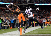Travis Benjamin of the Cleveland Browns can't make a catch in front of Shareece Wright of the Baltimore Ravens during the fourth quarter at...