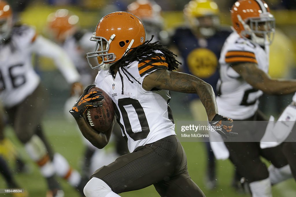 Travis Benjamin #80 of the Cleveland Browns runs with the football during a kick return in the second half of the game against the Green Bay Packers at Lambeau Field on October 20, 2013 in Green Bay, Wisconsin.