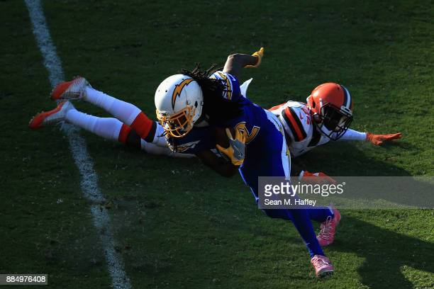 Travis Benjamin of the Los Angeles Chargers runs past Jabrill Peppers of the Cleveland Browns during the second half of a game at StubHub Center on...