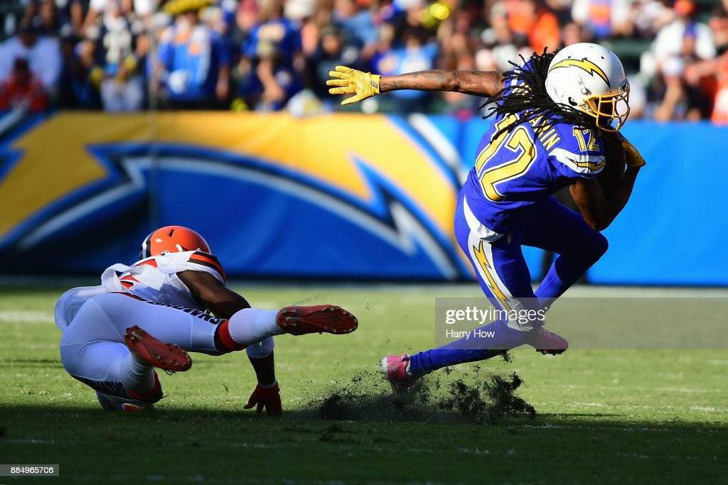 Travis Benjamin #12 of the Los Angeles Chargers turns up field while avoiding the tackle from Jabrill Peppers #22 of the Cleveland Browns during the third quarter of the game at StubHub Center on December 3, 2017 in Carson, California.