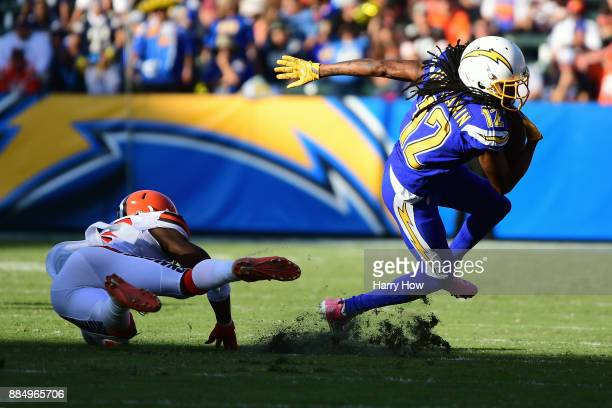 Travis Benjamin of the Los Angeles Chargers turns up field while avoiding the tackle from Jabrill Peppers of the Cleveland Browns during the third...