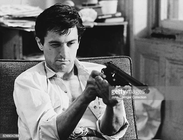 Travis Bickle checks out his revolver in the movie Taxi Driver