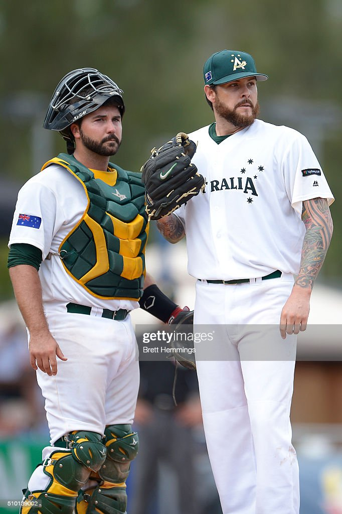 Travis Blackley (R) and Allan de San Miguel (L) of Australia look on during the World baseball Classic Final match between Australia and South Africa at Blacktown International Sportspark on February 14, 2016 in Sydney, Australia.