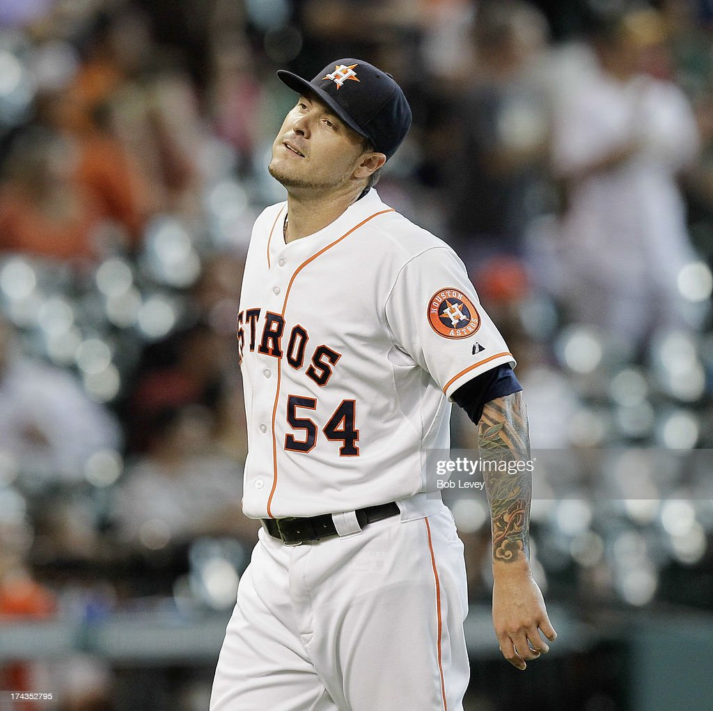 Travis Blackley #54 of the Houston Astros reacts after giving up a two-run home run to Coco Crisp of the Oakland Athletics in the seventh inning at Minute Maid Park on July 24, 2013 in Houston, Texas.