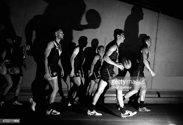 Travis Boak captain of the Power leads his side onto the field during the round three AFL match between the North Melbourne Kangaroos and the Port...