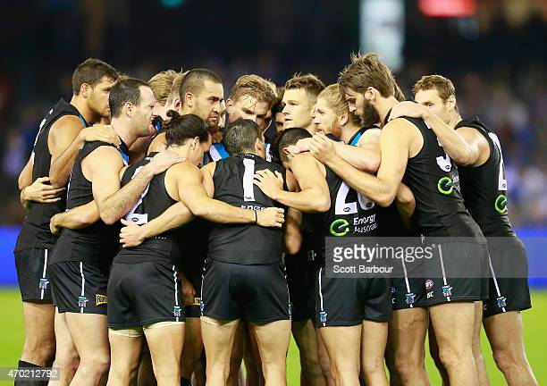 Travis Boak captain of the Power speaks to his team as they form a huddle during the round three AFL match between the North Melbourne Kangaroos and...