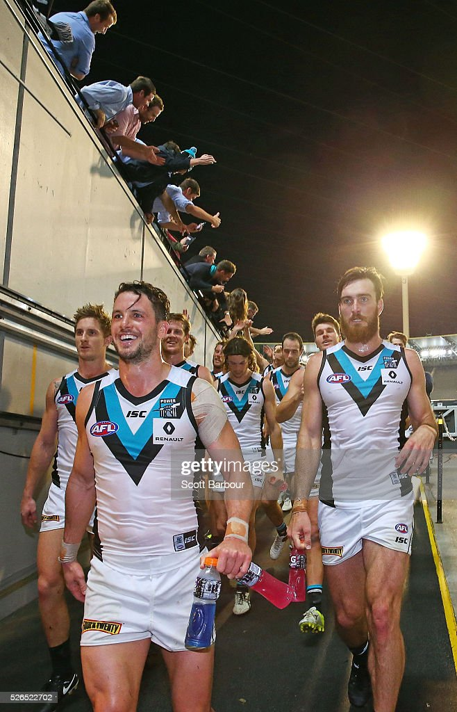 Travis Boak of the Power and his teammates celebrate winning the round six AFL match between the Richmond Tigers and the Port Adelaide Power at Melbourne Cricket Ground on April 30, 2016 in Melbourne, Australia.