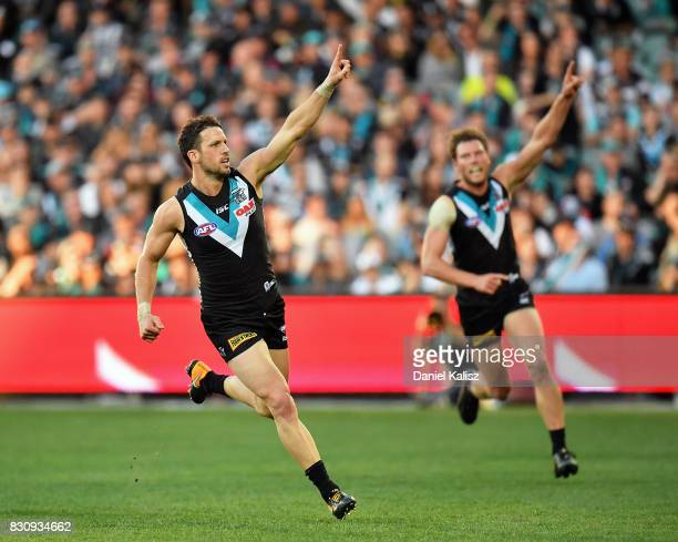 Travis Boak of the Power celebrates after kicking a goal with Brad Ebert of the Power during the round 21 AFL match between Port Adelaide Power and...