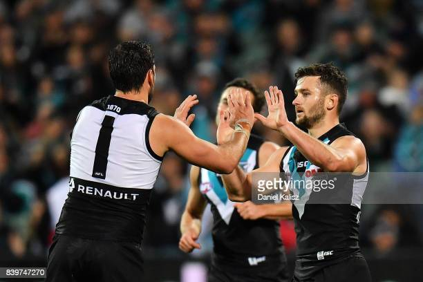 Travis Boak of the Power celebrates with Sam Gray of the Power during the round 23 AFL match between the Port Adelaide Power and the Gold Coast Suns...