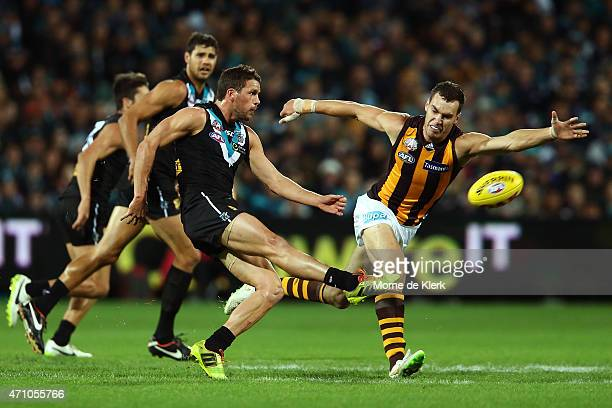 Travis Boak of the Power clears the ball from the centre during the round four AFL match between the Port Adelaide Power and the Hawthorn Hawks at...