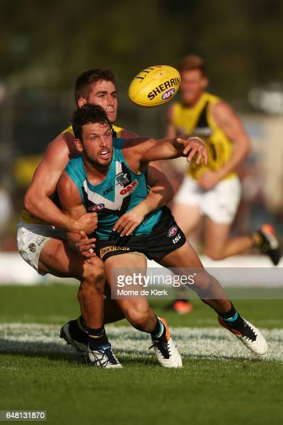 Travis Boak of the Power is tackled by Anthony Miles of the Tigers during the 2017 JLT Community Series AFL match between the Port Adelaide Power and...