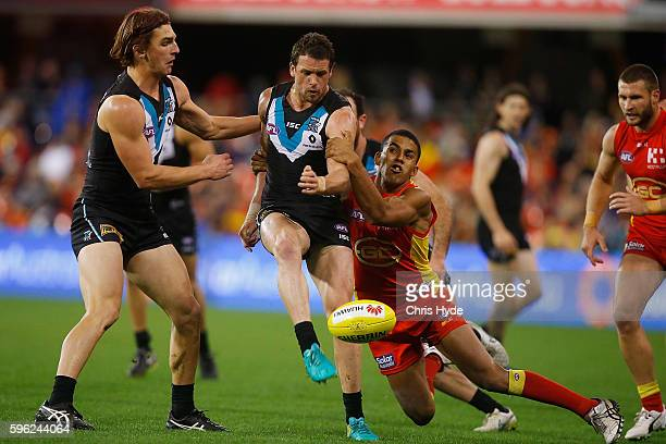 Travis Boak of the Power kicks during the round 23 AFL match between the Gold Coast Suns and the Port Adelaide Power at Metricon Stadium on August 27...