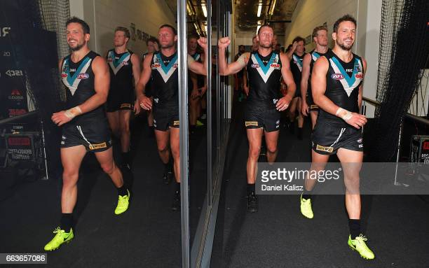 Travis Boak of the Power leads his players from the field after the round two AFL match between the Port Adelaide Power and the Fremantle Dockers at...