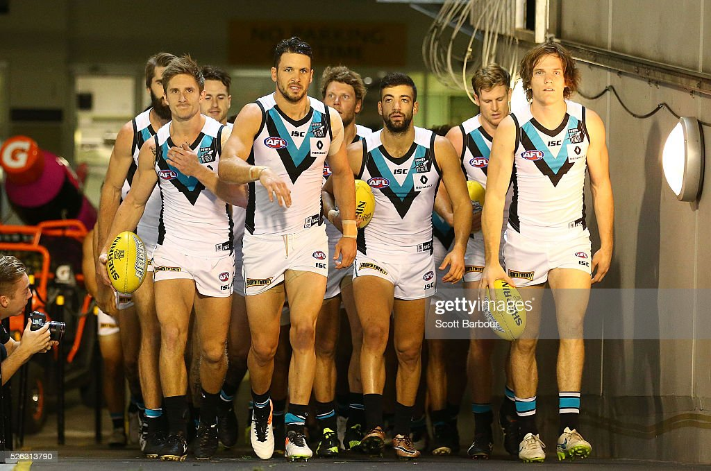 Travis Boak of the Power leads the Power onto the field during the round six AFL match between the Richmond Tigers and the Port Adelaide Power at Melbourne Cricket Ground on April 30, 2016 in Melbourne, Australia.