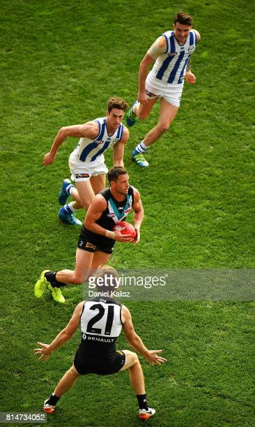 Travis Boak of the Power runs with the ball during the round 17 AFL match between the Port Adelaide Power and the North Melbourne Kangaroos at...