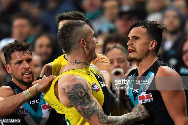 Travis Boak Sam PowellPepper of the Power and Dustin Martin of the Tigers wrestle during the round 15 AFL match between the Port Adelaide Power and...