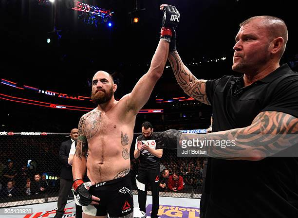 Travis Browne celebrates after his TKO victory over Matt Mitrione in their heavyweight bout during the UFC Fight Night event inside TD Garden on...