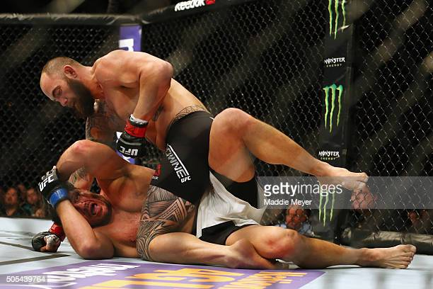 Travis Browne grapples with Matt Mitrione in their heavyweight bout during UFC Fight Night 81 at TD Banknorth Garden on January 17 2016 in Boston...